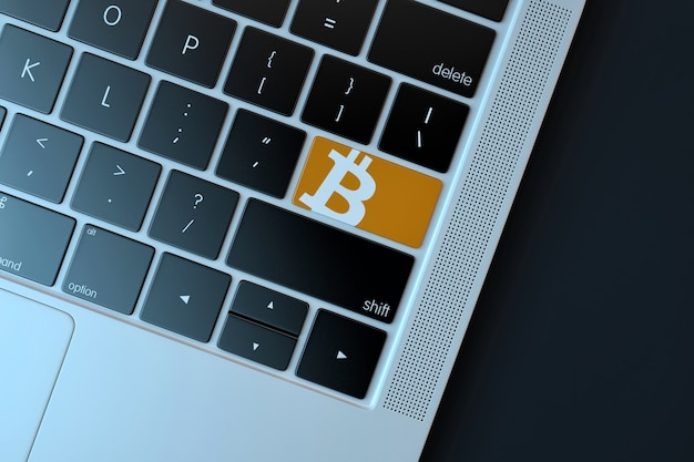 Bitcoin icon on laptop keyboard. technology concept