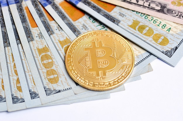 Bitcoin is a gold coin on dollar bills. financial concept