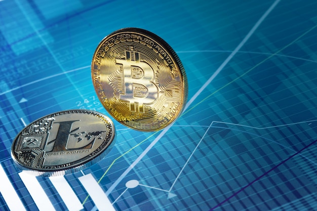Bitcoin and litecoin on blue abstract finance background. bitcoin cryptocurrency