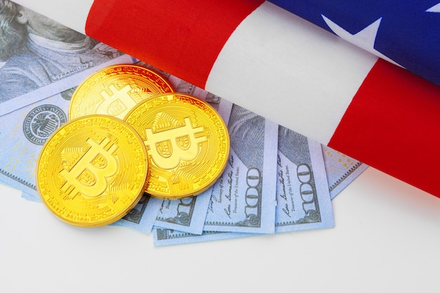 Bitcoin physical coins on american flag with dollars
