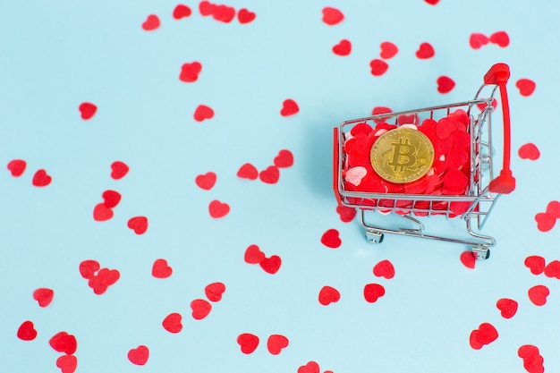 Bitcoin in shopping cart full of red hearts