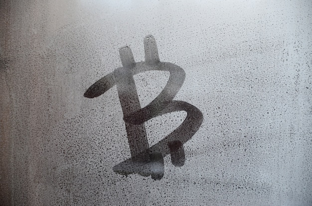 The bitcoin symbol on the misted sweaty glass. abstract background image.