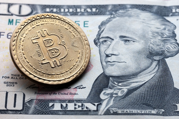 Bitcoin symbol on ten dollars background. cryptocurrency technologies concept.
