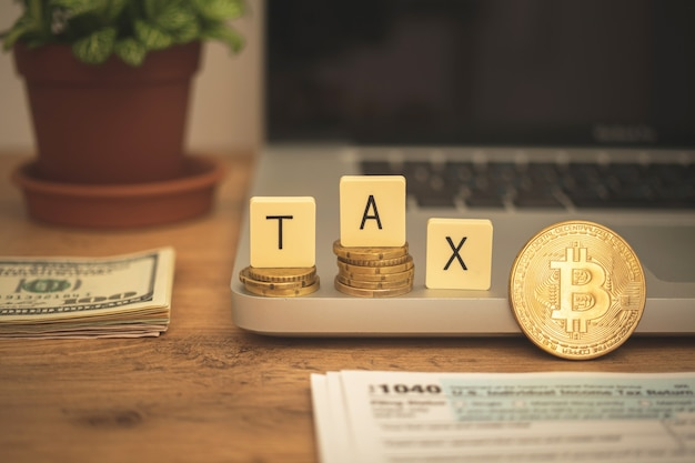 Bitcoin and tax background. cryptocurrency and taxation concept. business desktop with laptop and money
