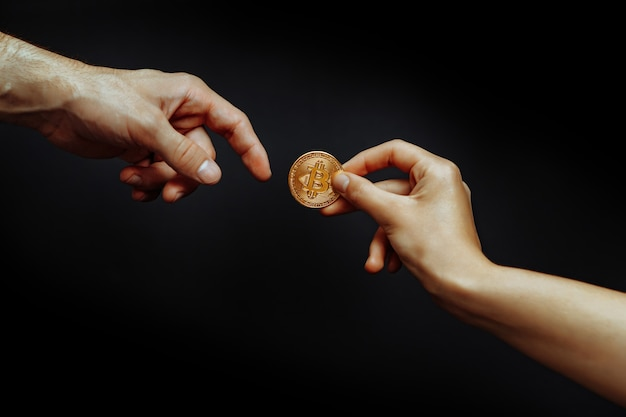 Bitcoin transfer concept from hand to hand high quality photo