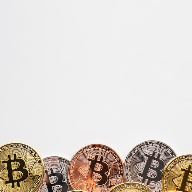 Bitcoin with various colors on plain background
