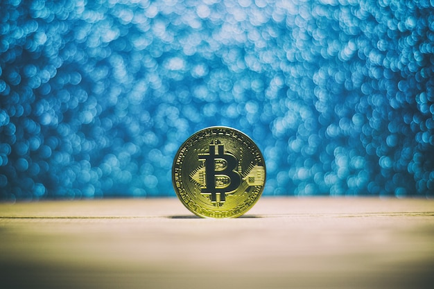 Bitcoin on wooden beautiful glittery background