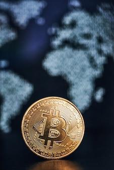 Bitcoin on world map surface