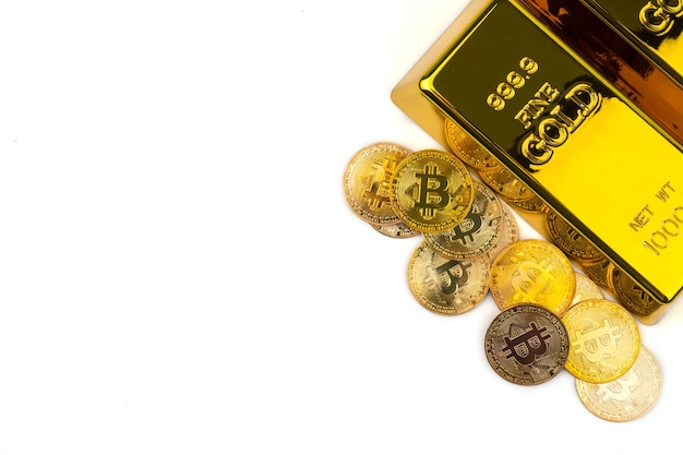 Bitcoins of new digital money and gold bars on white background