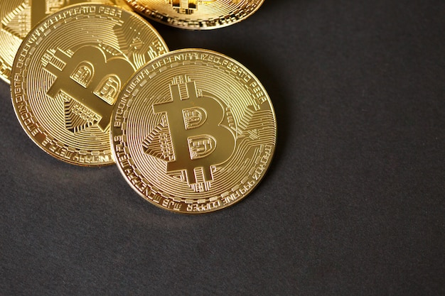 Bitcoins and virtual money. golden bitcoins. concept worldwide cryptocurrency