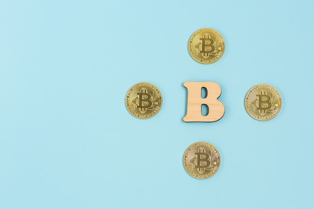 Bitcoins and wooden b letter