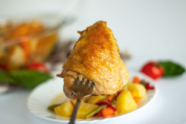 Bits of the roasted chicken with vegetables