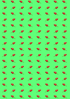 The bitter chili pepper and paprika on a green background. the abstract pattern background.
