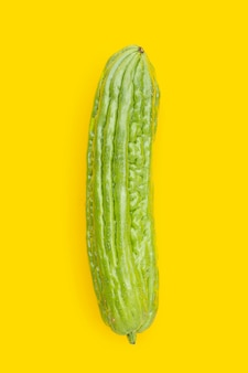 Bitter melon on yellow background.
