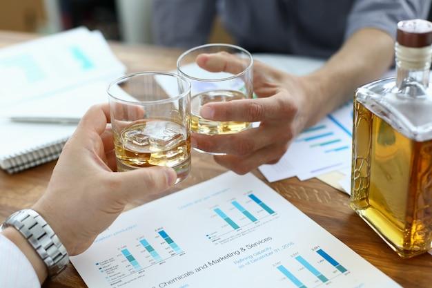 Biz partners drinking in office