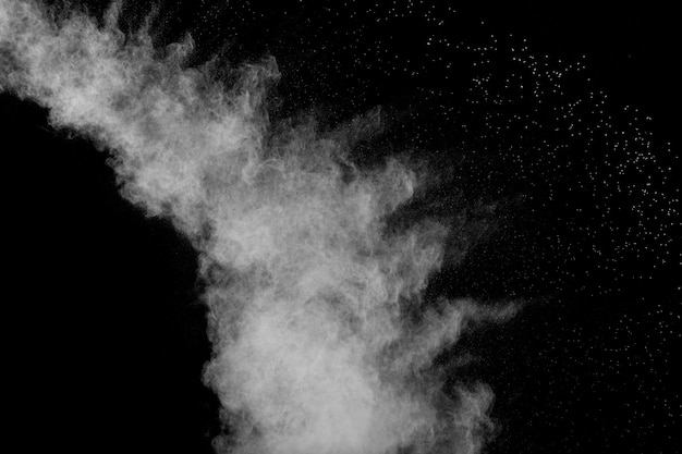 Bizarre forms of white powder explosion cloud against black background