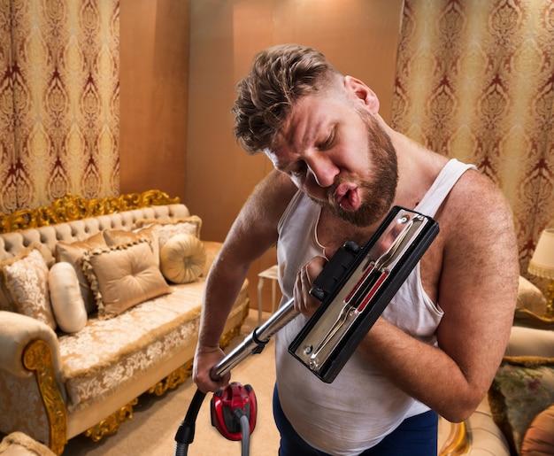 Bizarre man sings to the vacuum cleaner