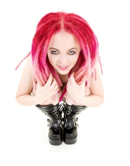 Bizarre pink hair girl in high boots