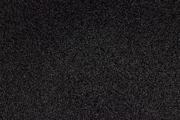 Black abstract background or texture, black rough background. waterproof abrasive paper texture. black sandpaper texture.