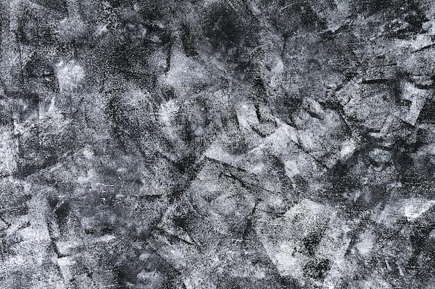 セメントの質感と黒の抽象的な背景
