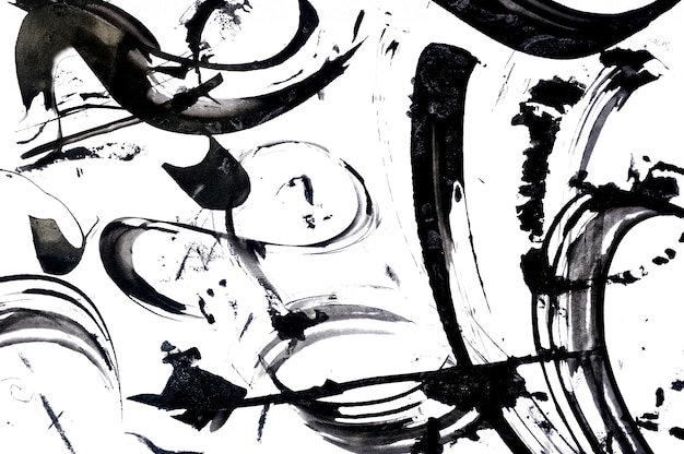 黒の抽象的なブラシストロークと紙の上の塗料の飛散。グランジアート書道の背景
