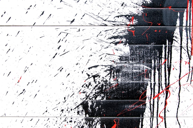 Black abstract paint splashes on white