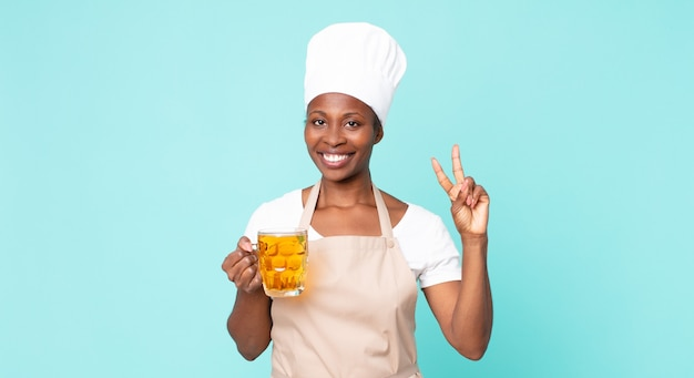Black african american adult chef woman with a pint beer
