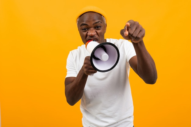 Black african man shouting into a megaphone