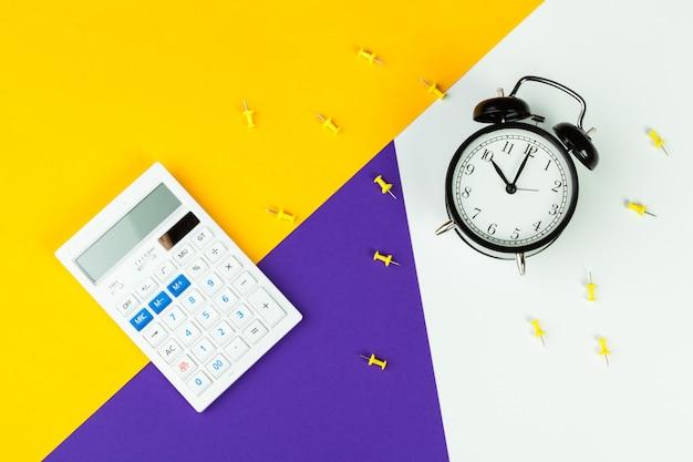 Black alarm clock and calculator, office supplies