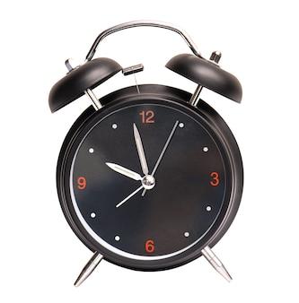 白い背景で隔離の黒い目覚まし時計