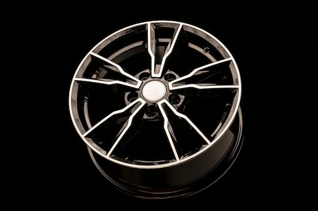 黒い湾曲したスポークを備えた黒い合金ホイール。珍しいスタイリッシュなデザイン。自動チューニング技術と車のファッションとスタイル
