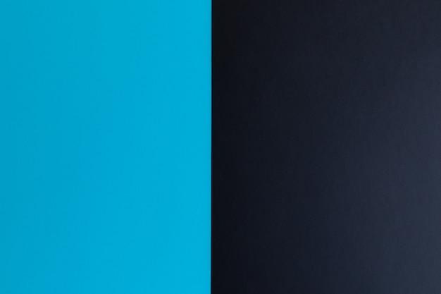 テキスト用のスペースがある黒と青のパステルカラーの紙の表面