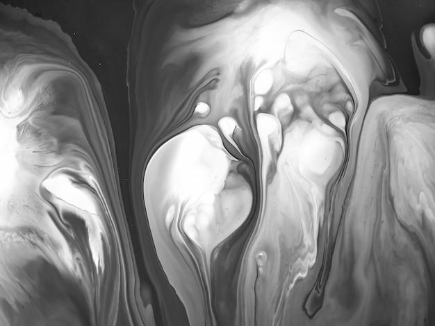 創造的なデザインのための抽象的な有機的な形の黒と白のアクリル絵の具のテクスチャ