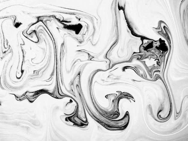 抽象的な有機的な形の黒と白のアクリル絵の具のテクスチャ