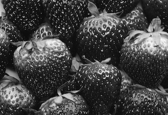 Black and white macro of yummy strawberries background