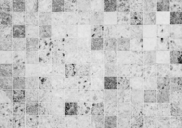 黒と白の大理石の石のタイルの壁のテクスチャ
