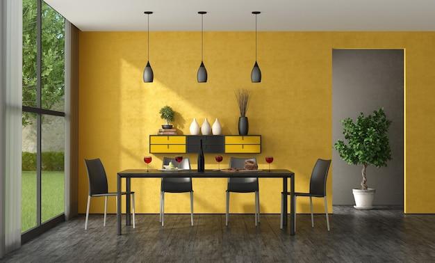 木製のテーブルと革張りの椅子のある黒と黄色のダイニングルーム