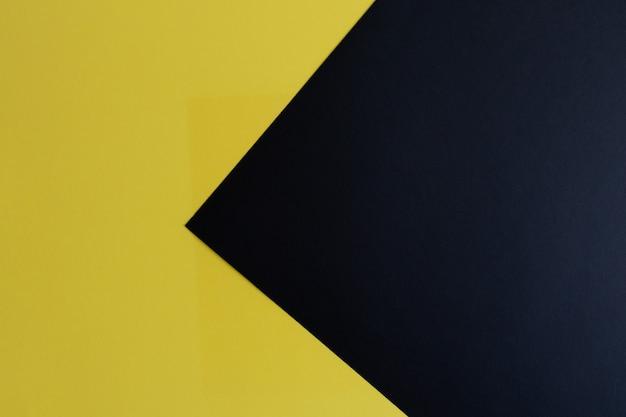 テキスト用のスペースがある黒と黄色のパステルカラーの紙の表面