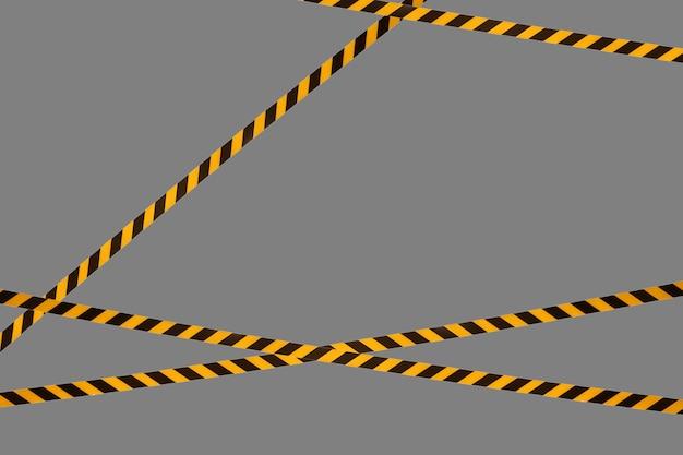Черно-желтые предупреждающие полосы заградительной ленты запрещают проезд. барьерная лента на сером изоляте. барьер, запрещающий движение. предупреждение об опасной опасной зоне: не входить. концепция запрета входа. копировать пространство