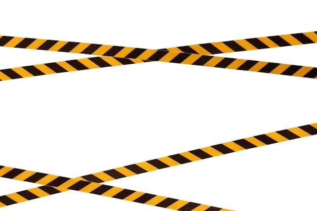 Черно-желтые предупреждающие полосы заградительной ленты запрещают проезд. барьерная лента на белом изоляте. барьер, запрещающий движение. предупреждение об опасной опасной зоне: не входить. концепция запрета входа. копировать пространство