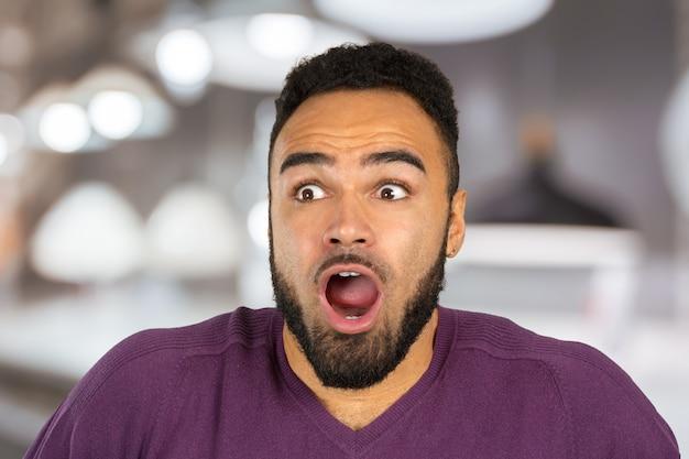 Black anxious stressed young man looking at camera