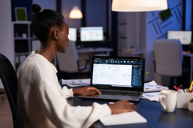 Black architect using cad softwer to build buildig plan, blue prints