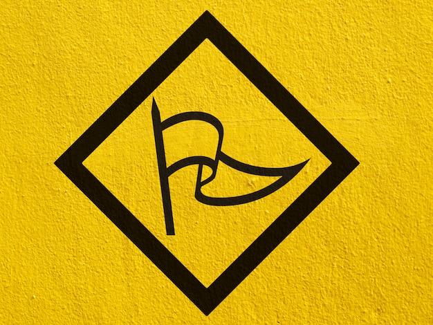 A black arrow points painted on a stucco wall outside