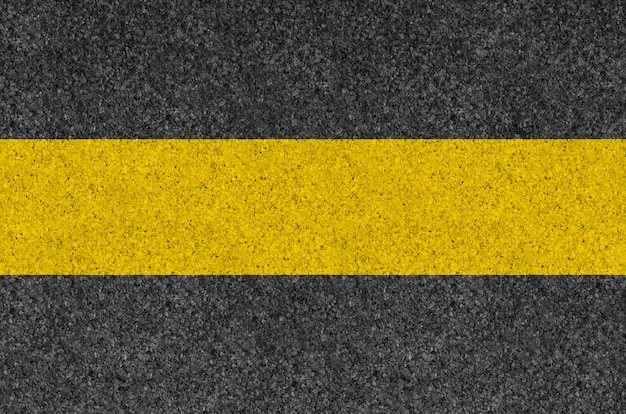 Black asphalt background texture with yellow line