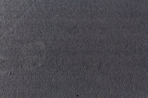 Black asphalt road, background texture close-up