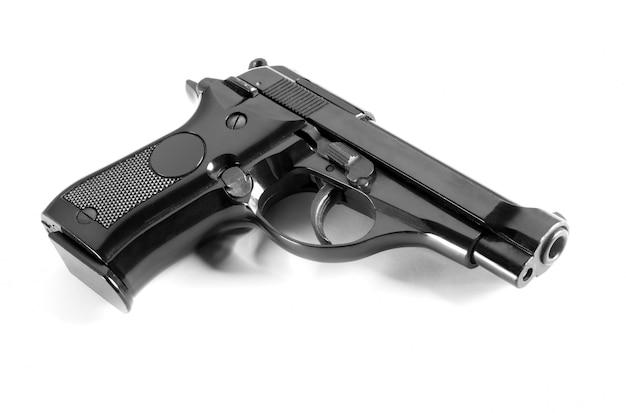 Black automatic handgun on white