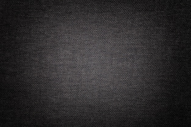 Black background from a textile material, fabric with natural texture, backdrop,