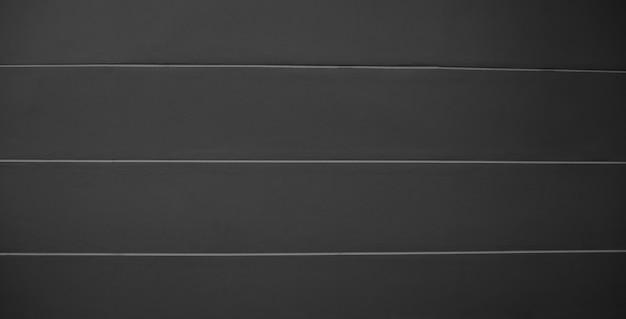 黒の背景のストライプ、テクスチャ、灰色の黒、バスルームの前のセメントの壁