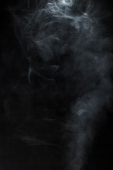 Black background with blurred smoke