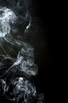 Black background with smoke silhouette